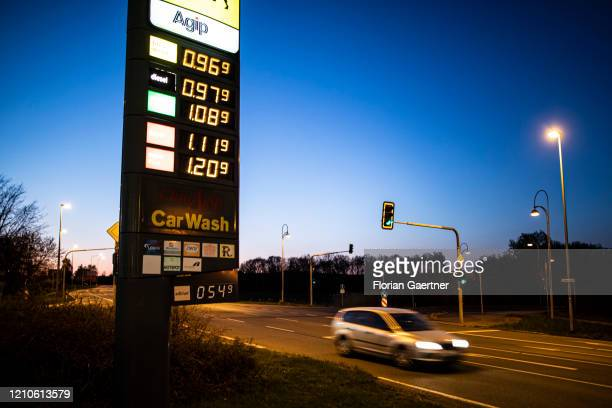 Price board in front of a petrol station with very low prices is pictured on April 21, 2020 in Loebau, Germany. Because of the decreasing demand for...
