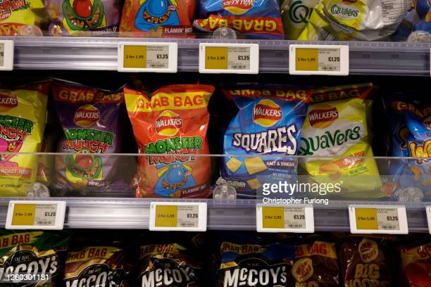 Price deal is seen advertising advertising snacks in a shop on July 27, 2020 in Birmingham, United Kingdom. The British government plans to more...
