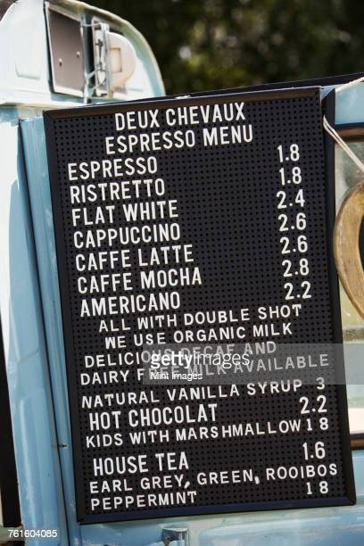 Price list for hot drinks on a blue mobile coffee shop.
