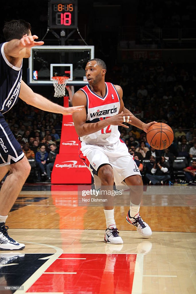 A.J. Price #12 of the Washington Wizards handles the ball against the Oklahoma City Thunder at the Verizon Center on January 7, 2013 in Washington, DC.