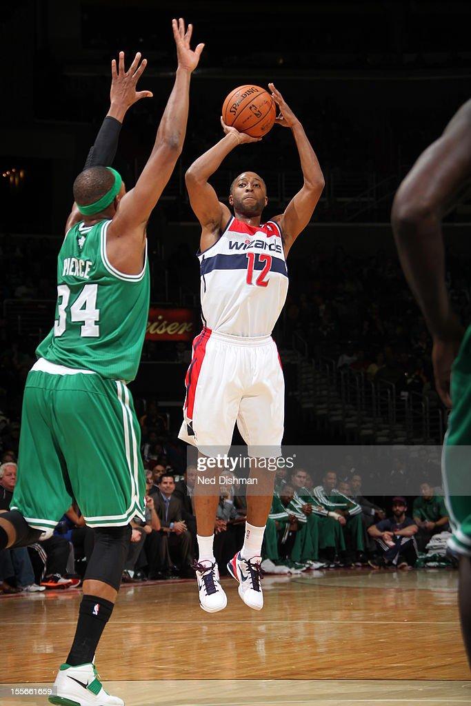 A.J. Price #12 of the Washington Wizards shoots against Paul Pierce #34 of the Boston Celtics at the Verizon Center on November 3, 2012 in Washington, DC.