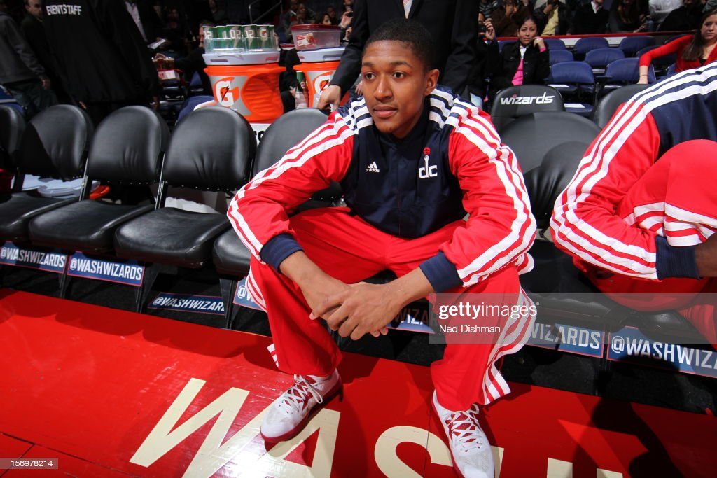 A.J. Price #12 of the Washington Wizards sitting on the bench before the game against the Charlotte Bobcats during the game at the Verizon Center on November 24, 2012 in Washington, DC.
