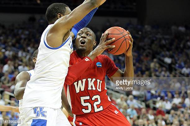 J Price of the Western Kentucky Hilltoppers drives inside in the first half against Terrence Jones of the Kentucky Wildcats during the second round...