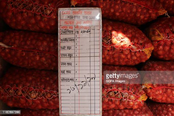 A price tag hangs on sacks of onions at a wholesale shop in Dhaka Onion prices have rocketed in Bangladesh after India banned its export over local...
