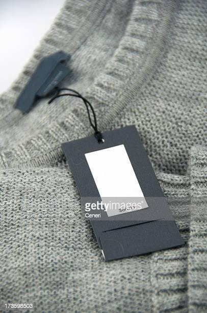 price tag on gray cardigan