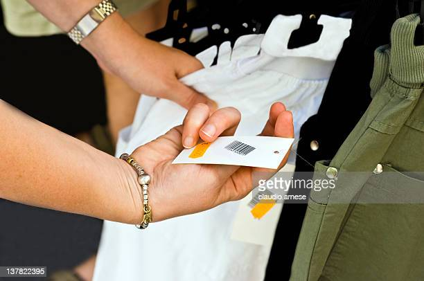 Price Tag with Hands. Color Image