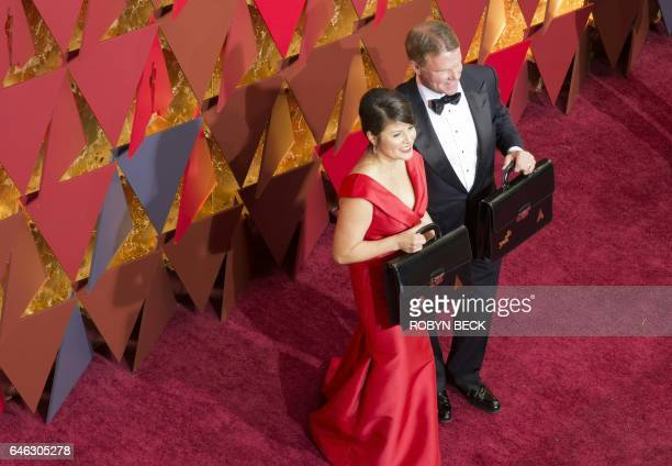 Price Waterhouse and Coopers representatives Martha L Ruiz and Brian Cullinan attend the 89th Annual Academy Awards in Hollywood California February...