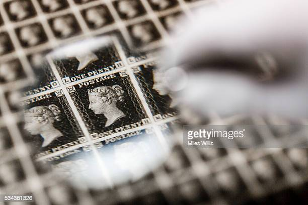A priceless sheet of Penny Blacks the world's first ever postage stamp is inspected prior to heading abroad for the first time in a specially...
