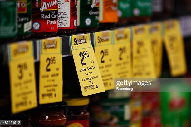 Prices for assorted products are displayed at a Woolworths Ltd supermarket in Sydney Australia on Thursday Aug 27 2015 Woolworths Australias largest...
