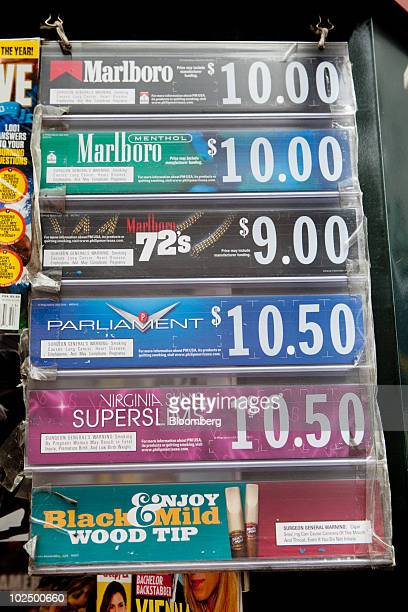 Prices for Marlboro Parliament and Virginia Slims cigarettes are displayed at a store in New York US on Monday June 28 2010 The US Supreme Court...