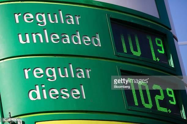 Prices for unleaded fuel and diesel fuel sit on a totem sign outside a gas station operated by BP Plc in London UK on Tuesday Feb 2 2016 BP Plc...