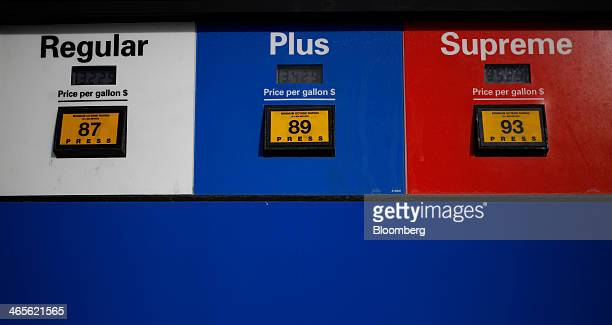 Prices of different grades of gas are displayed at an Exxon Mobil Corp station in Cincinnati Ohio US on Monday Jan 27 2014 Exxon Mobil Corp is...