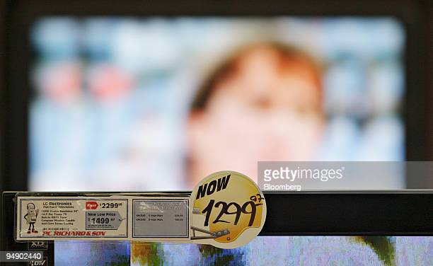 A pricetag that features a football helmet graphic hangs on a flatscreen television inside a PC Richard Sons in New York US on Thursday Jan 31 2008...