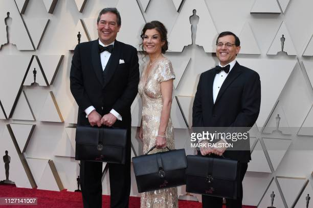 PricewaterhouseCooper representatives carrying the awards envelopes arrive for the 91st Annual Academy Awards at the Dolby Theatre in Hollywood...