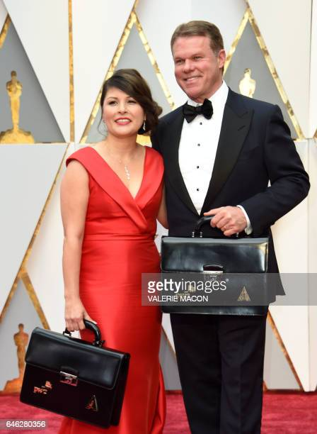 PriceWaterhouseCooper representatives Martha L Ruiz and Brian Cullinan the only two people who know the results carry two briefcase with the winning...