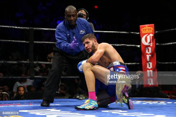 Prichard Colon falls to the ring after taking a punch from Terrel Williams in their super welterweights bout at EagleBank Arena on the campus of...