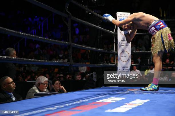 Prichard Colon holds the back of his head after taking a punch from Terrel Williams in their super welterweights bout at EagleBank Arena on the...