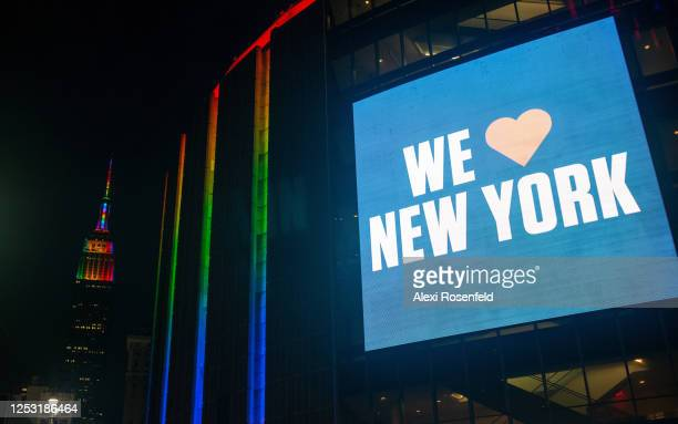 A pride colored Madison Square Garden displays a digital screen that reads We love New York near a pride colored Empire State Building on June 28...