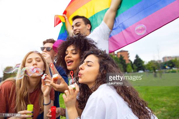 pride day! friends celebrating - lgbtqi pride event stock pictures, royalty-free photos & images