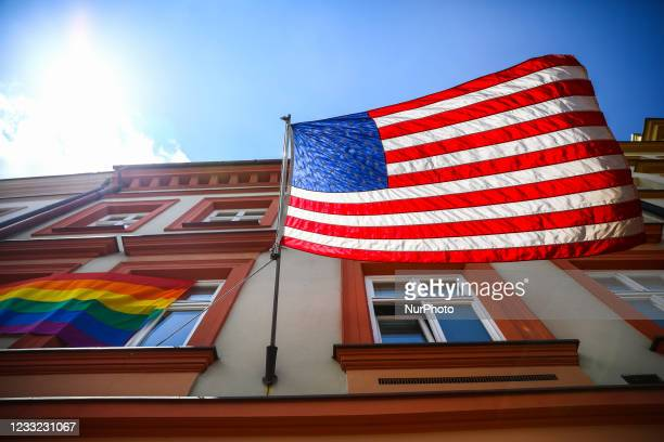 Pride flag is hanging next to the US national flag over the entrance to the the U.S. Consulate General in Krakow, Poland on June 2nd, 2021. Bidens...