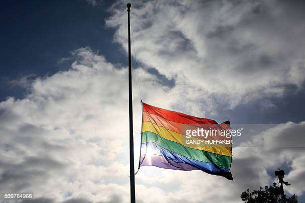 TOPSHOT A pride flag stands a half mast during a memorial service in San Diego California on June 12 for the victims of the Orlando Nighclub shooting...