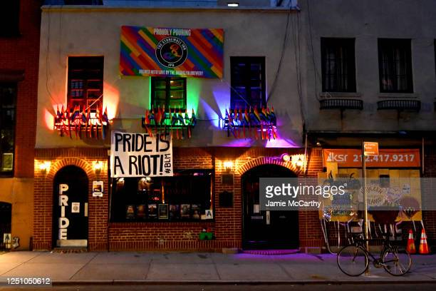 Pride flags and Black Lives Matter signs decorate The Stonewall Inn on June 20, 2020 in New York City. Due to the ongoing Coronavirus pandemic, this...