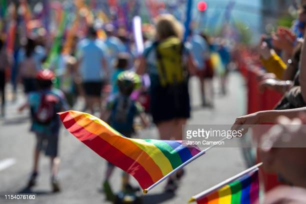 pride flags at the parade - ゲイ・パレード ストックフォトと画像