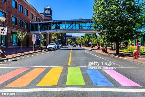 pride rainbows crosswalks in moncton - moncton stock photos and pictures