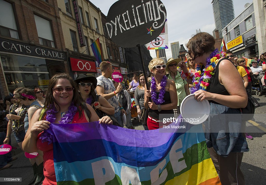Pride Toronto Dyke March works its way through the downtown core as marchers celebrate Pride Toronto festivities, on Saturday, June 29, 2013. The larger extravaganza of the Pride Parade is set for Sunday.