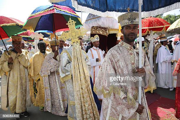 PriesSt and deacons escort the Tabot from Saint George Church during the procession to Janmeda on the first day of the three day Epiphany...