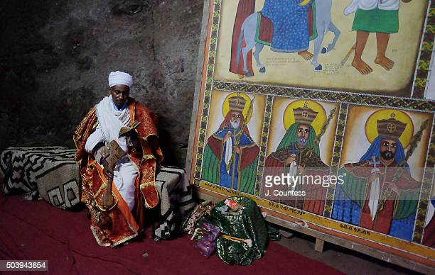 Priest Abebe Dawit reads scripture at Beta Uriel on January 7 2016 in Lalibela Ethiopia Thousands of adhearants to the Ethiopian Orthodox Faith...