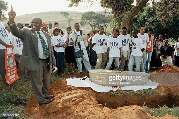 A priest addresses the crowd at the funeral of TAC activist Ncane Surprise Xulu at the cemetery in Umlazi Township near Durban She died of...