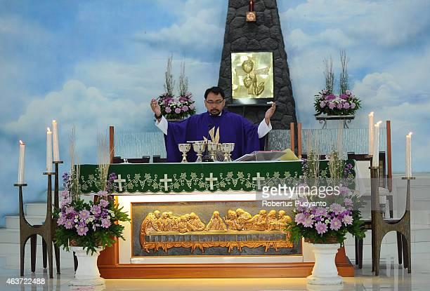 Priest Aloysius Widyawan RD leads the Ash Wednesday Mass at Roh Kudus Church on February 18 2015 in Surabaya Indonesia Ash Wednesday marks the...