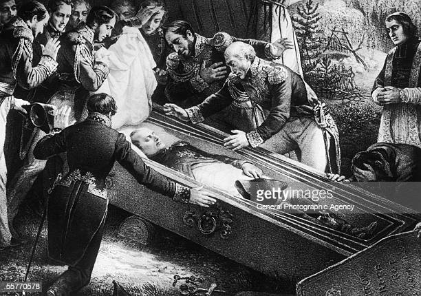 A Priest and a group of English officers gather round the coffin of exiled former French Emperor Napoleon Bonaparte after his death on the island of...
