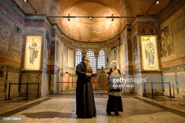 Priest and a woman visit the Chora or Kariye Museum, formally the Church of the Holy Saviour, a medieval Byzantine Greek Orthodox church, on August...