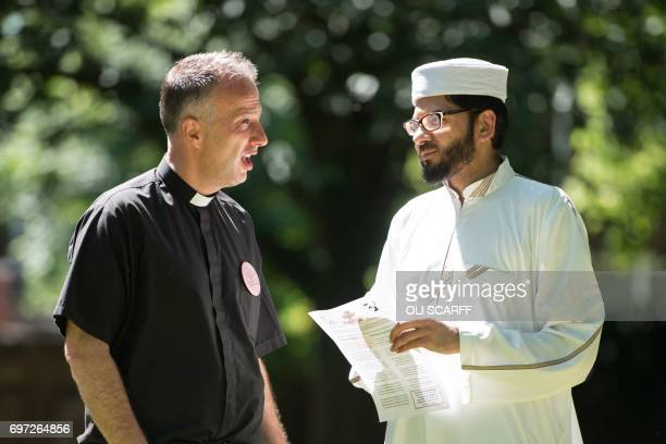 A priest and an imam chat before addressing members of the public at a 'Great Get Together' community service and picnic in memory of murdered Member...