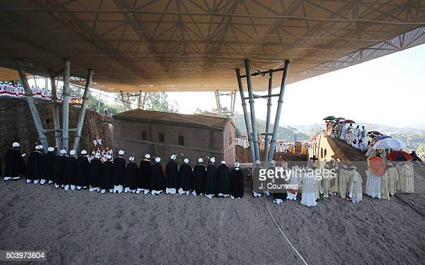 Priest and deacons march in a processional around Beta Mariam Church on January 8 2016 in Lalibela Ethiopia Amoungst the numerous icons and crosses...