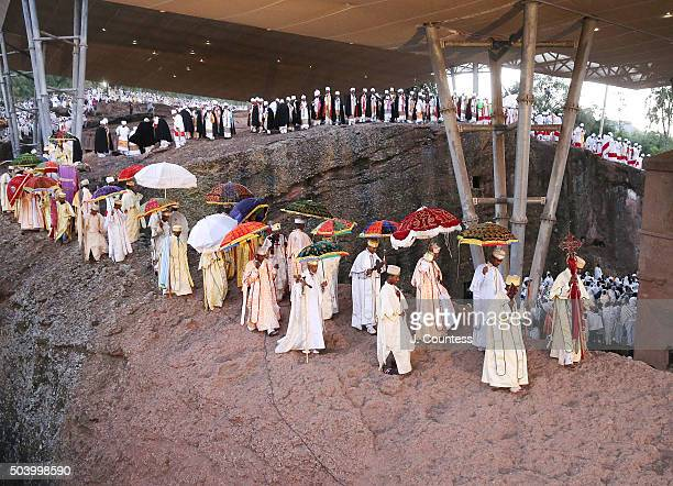 Priest and deacons march in a processional around Beta Mariam Church on January 8 2016 in Lalibela Ethiopia Thousands of adherents to the Ethiopian...