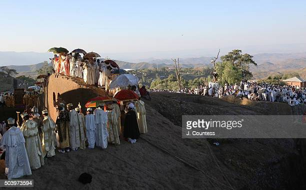 Priest and deacons pause during a processional around Beta Mariam Church on January 8 2016 in Lalibela Ethiopia Amoungst the numerous icons and...