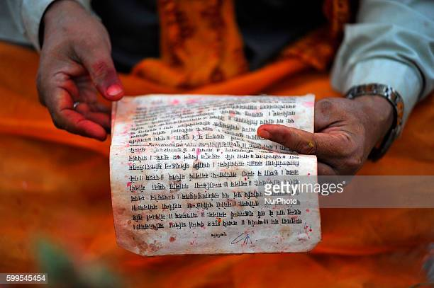 A Priest arranging for offering ritual prayer at the Bank of Bagmati River of Pashupatinath Temple during Rishi Panchami Festival celebrations at...