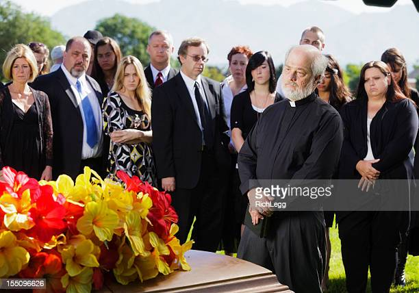 priest at a funeral - mourning stock pictures, royalty-free photos & images