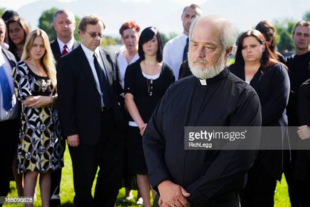 priest at a funeral - rest in peace stock photos and pictures