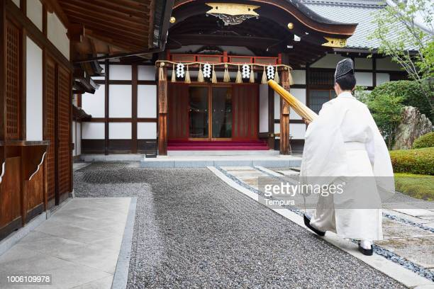 priest at inari shrine - shrine stock pictures, royalty-free photos & images