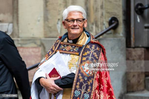 Priest attends a church service at Stockholm Cathedral in connection with the opening of the Swedish Parliament for the fall session on September 8,...
