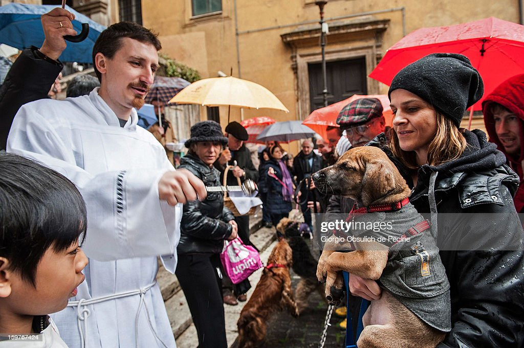 A priest blesses a dog after a traditional mass for the blessing of animals at the Sant'Eusebio church on January 20, 2013 in Rome, Italy. Every year during the feast of St. Anthony the Abbot animals are blessed in countries around the world.