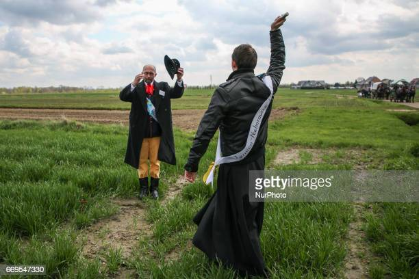 A priest blesses a field crop during traditional horse riding procession on Easter Monday in Zernica village near Gliwice Poland 17 April 2017 During...