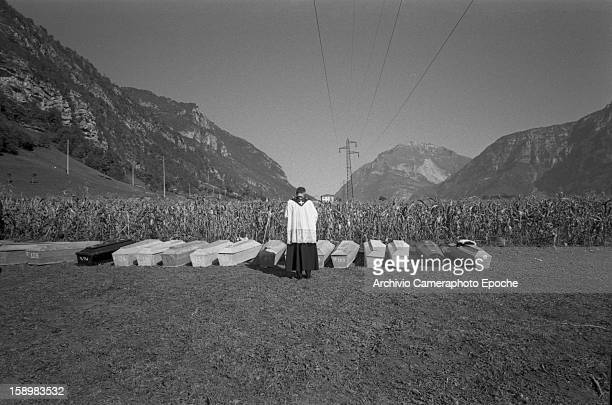 A priest blesses a line of coffins after the disasterLongarone near the Vajont Dam in the Piave Valley Italy early October 1963 On October 9 a...