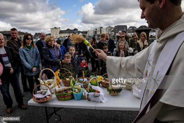 A priest blesses Easter baskets ahead of the Christian feast of Easter at The St Mary's Church Claddagh on Saterday March 31 in Galway Ireland Polish...