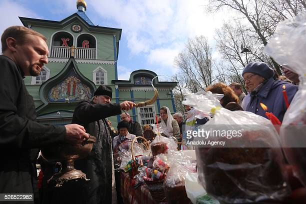 A priest blesses Easter cakes eggs and believers on Orthodox Holy Saturday at a church in SaintPetersburg Russia on April 29 2016