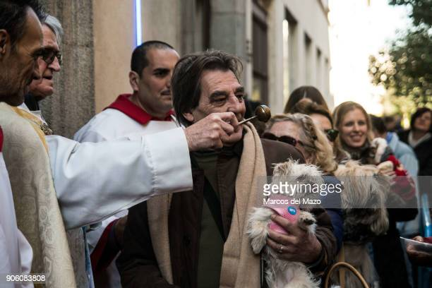 A priest blessing a dog in San Anton Church during the celebration of Saint Anthony the Abbot patron saint of domestic animals
